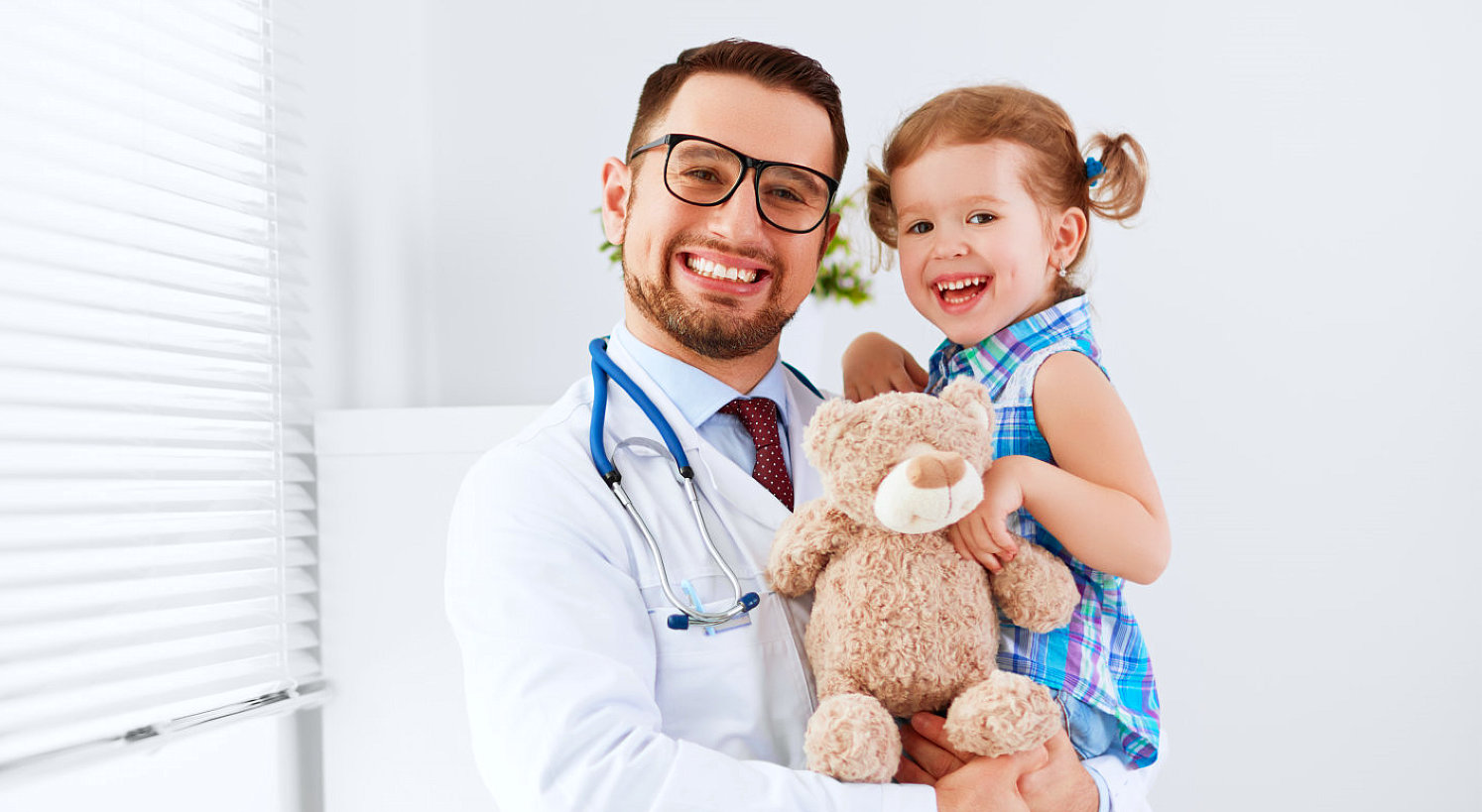 male doctor carrying a child