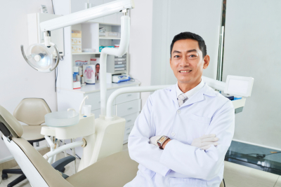 male asian doctor smiling