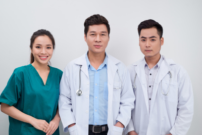 group of asian medical doctors and nurse smiling