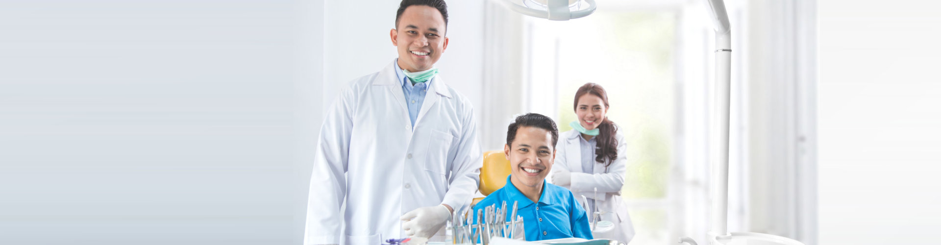 two doctors smiling with their patient